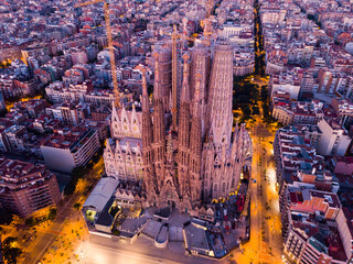 Night aerial cityscape of Barcelona with Sagrada Familia designed by Anthony Gaudi