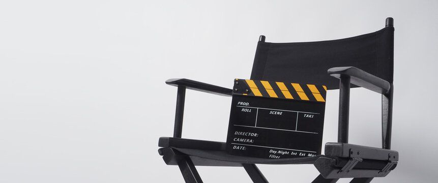 Director chair with black and yellow clapper board or movie slate on white background.it is used in video production and film industry.