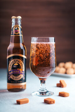 GIRONA, SPAIN - FEBRUARY 19, 2020: Flying Cauldron Butterscotch Beer, famous delicious drink from Harry Potter world on wooden background