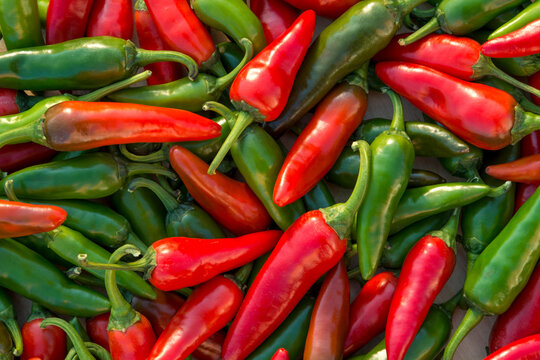 Shot of  green and red hot chili peppers on the table