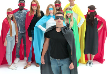 Photo sur Plexiglas Dinosaurs confident guy in a Superman Cape standing in front of his team
