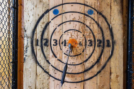 Axe throwing target with axe in center on bullseye