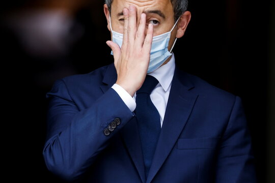 French Interior Minister Gerald Darmanin touches his face ahead of a visit of the French President Emmanuel Macron about the fight against separatism at the Seine-Saint-Denis prefecture headquarters in Bobigny