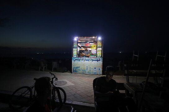 A Palestinian man sells hot drinks on a beach after the coronavirus disease (COVID-19) restrictions were eased, in the northern Gaza Strip