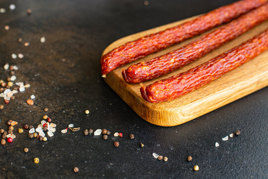 smoked sausages dry-cured meat meal on the table tasty serving size portion top view copy space for text food background rustic