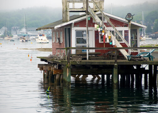Fishing village docks on the water in Boothbay Harbor Maine