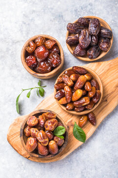 Dates or dattes palm fruit in wooden bowl is snack healthy.