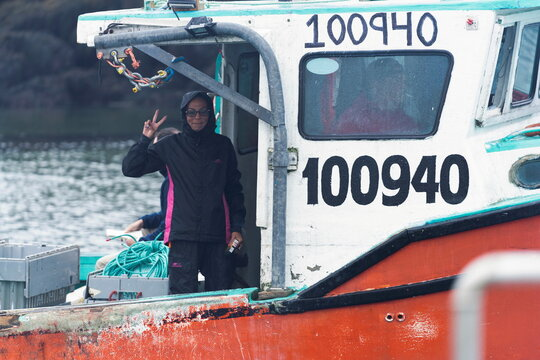 An Indigenous lobster fishing boat departs the harbour in Saulnierville