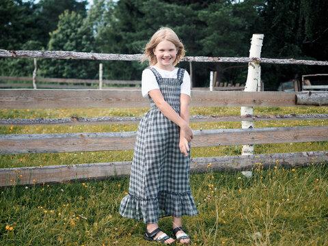 Portrait of a cute girl on a farm