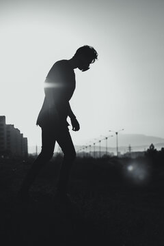 silhouette of a person walking outdoors
