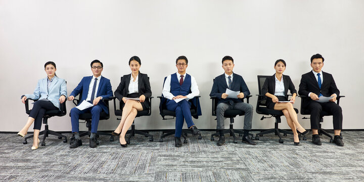 asian business people waiting in line for job interview