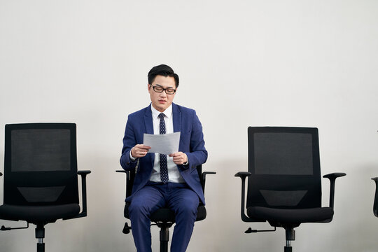 young asian businessman preparing for job interview