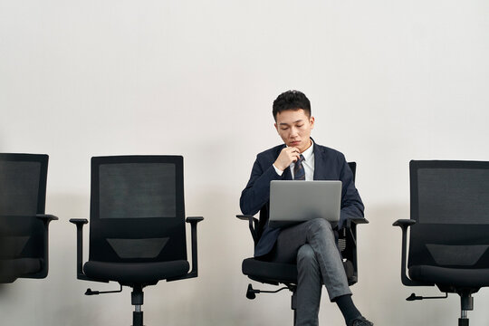 young asian business man preparing for job interview