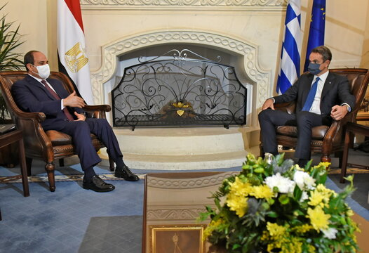 Greece's Prime Minister Kyriakos Mitsotakis and Egypt's President Abdel Fattah al-Sisi  talk  during a meeting at a trilateral summit between Greece, Cyprus and Egypt, at the Presidential Palace in Nicosia