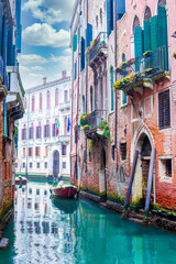 Famous canal in Venice city in Italy gondolas and classic buildings around
