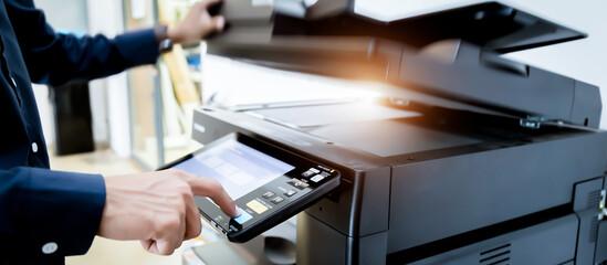 Bussiness man Hand press button on panel of printer, printer scanner laser office copy machine supplies start concept. Fototapete