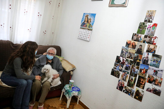 Florentina Martin, a 99 year-old woman who survived coronavirus disease (COVID-19), sits with her granddaughter Noelia Valle in her home in Pinto