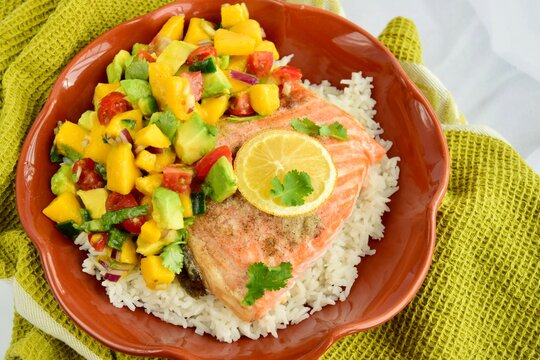 Baked salmon with coconut rice and mango salsa