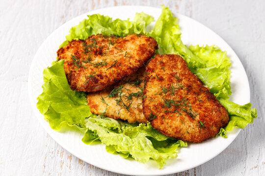 fresh lettuce, breaded pork chop