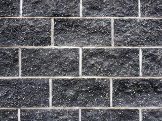 Black brick wall background texture.