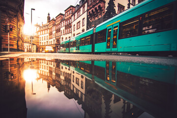 Frankfurt in Germany, a great city with many old houses and skyscrapers. Sunset or sunrise photo with reflections in puddles, beautiful urban street images Fotomurales