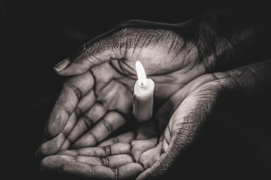 person hand with candle