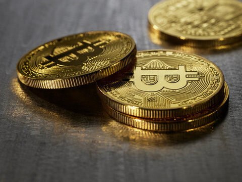 Bitcoins against a steel surface