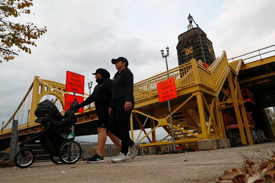 A man and a woman push a baby carriage amid the coronavirus disease (COVID-19) pandemic in Pittsburgh, Pennsylvania