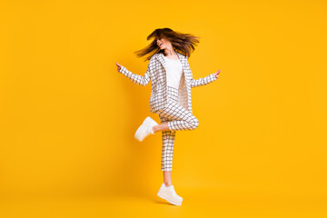 Full length body size side profile photo of girl wearing white checkered suit roung sunglass dancing isolated on vivid color background