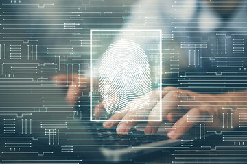 Fingerprint hologram with businessman working on computer on background. Security concept. Double...