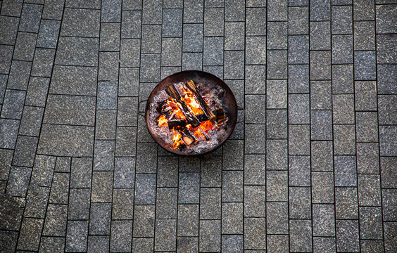fire place in front of a restaurant in a city