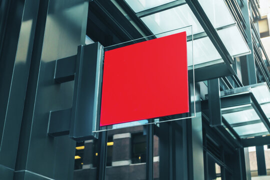 Red square signboard on the wall of a modern shopping mall, mock up