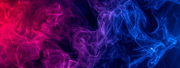 Fototapeta Conceptual image of colorful red and blue color smoke on dark black background. obraz