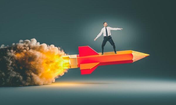 man riding a rocket pencil.
