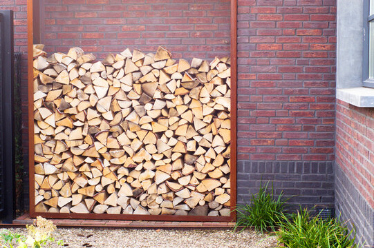 Stacked firewood outside for the fireplace