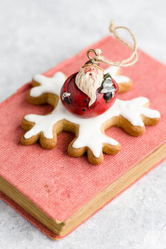 Small decoration of Santa Claus on the book.