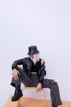Sexy blonde model in fashion urban street outfit. Trendy black bucket hat and bomber.  Stylish Fall winter seasons. Back in 90s Girl