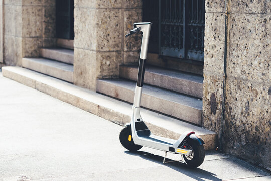 E-scooter for rent for mobility in the city. Electric scooter for public sharing in european city center, public mobile transportation.