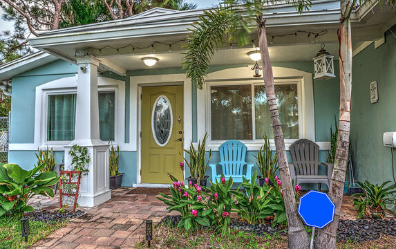 Blue and green beach bungalow porch in tropical Naples