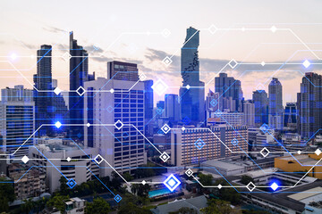 Glowing hologram of technological process, aerial panoramic cityscape of Bangkok at sunset. The largest innovative hub of tech services in Asia. Multi exposure.