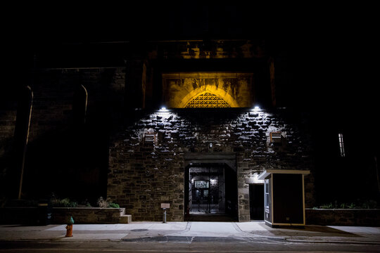The Eastern State Penitentiary, a ballot drop box location for the upcoming presidential election, is illuminated at night in Philadelphia, Pennsylvania