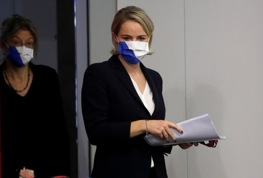 Zurich's head of Department of Health Rickli and Cantonal physician Meier wear protective masks in Zurich