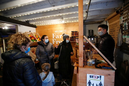 Customers are seen inside The Farm Fresh Market, a farm shop that has offered free lunches to children who need it over half term, as the spread of coronavirus diseases (COVID-19) continues, in Watnall, Nottingham