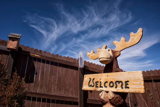 Moose with welcome sign;  Wyoming