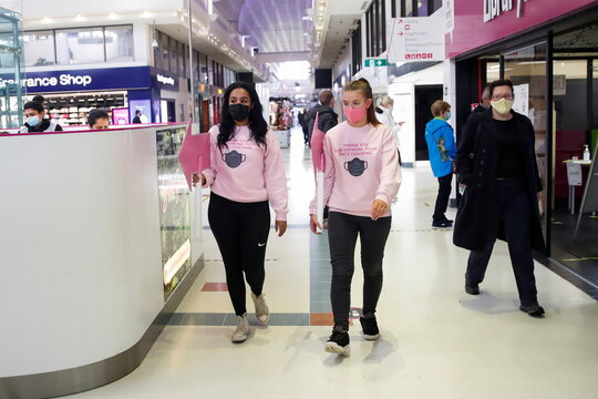 Pink patrollers help and advise people to socially distance and wear masks inside the Weston Favell Shopping centre, in Northampton