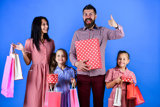 happy family go shopping. have a happy holidays. mother father and children prepare for celebration. big sale begin. black friday concept. family hold packages and presents