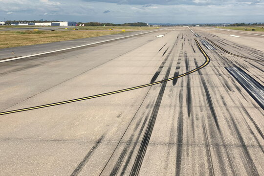 Skid marks from airplane tires mark a runway at the Nashville International Airport in Nashville
