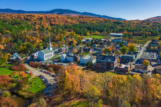 Aerial view of charming small town Stowe in Vermont. Mountains with fall multicolor trees