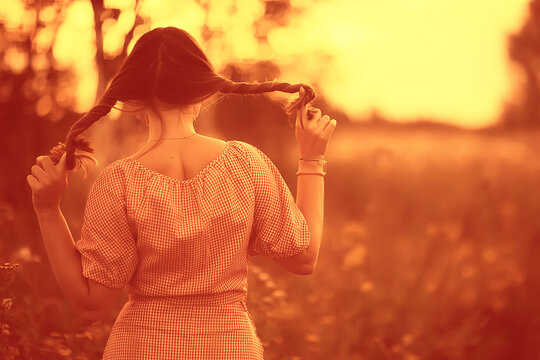 pigtails view from the back, young adult girl rustic style happiness freedom summer, no face