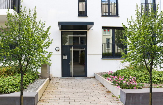 View to entrance door of a modern residential building with new apartments in the city
